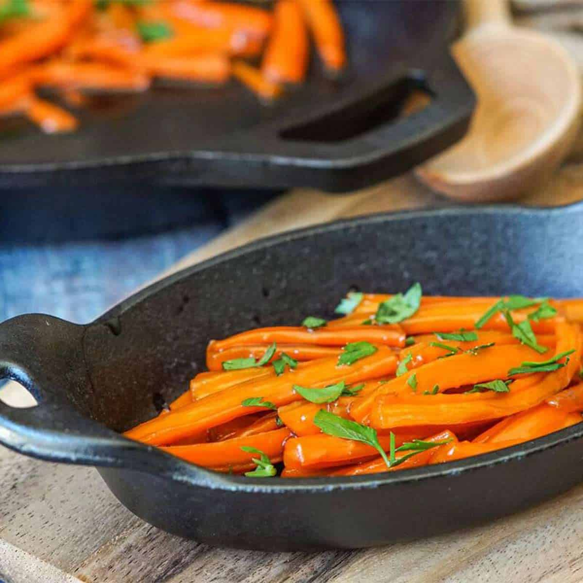 Brown sugar glazed carrots in a small cast iron dish