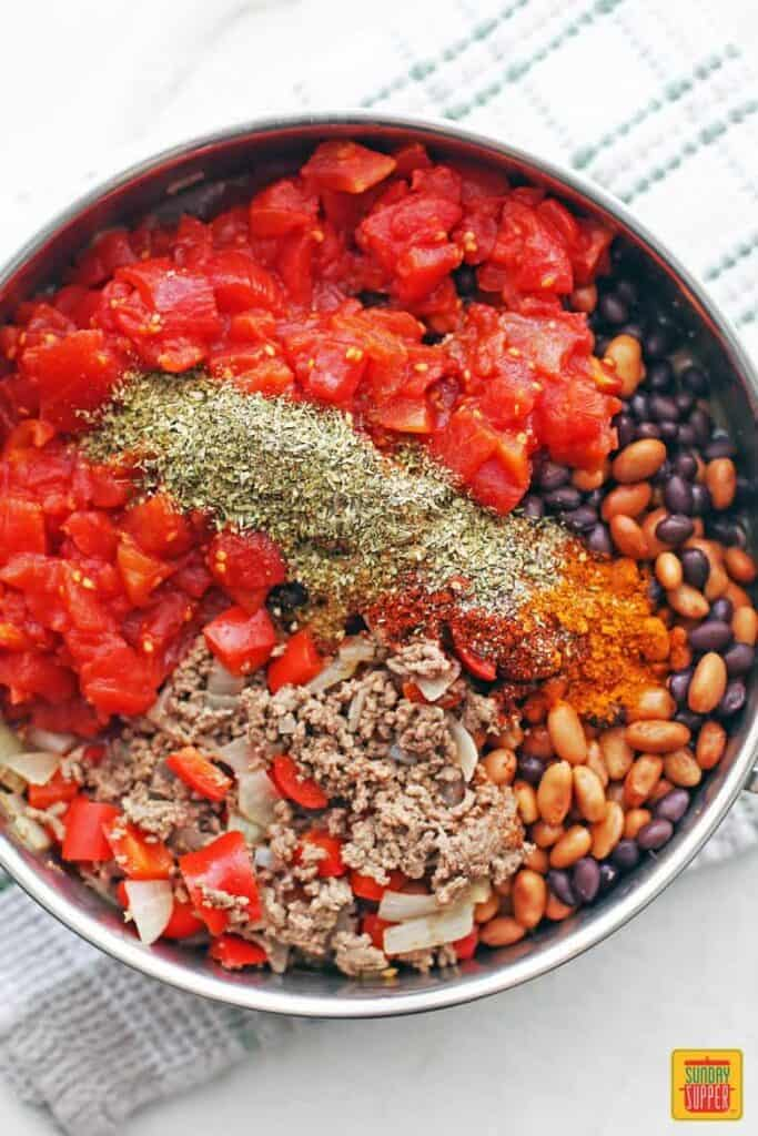 Ground beef chili recipe ingredients in a bowl