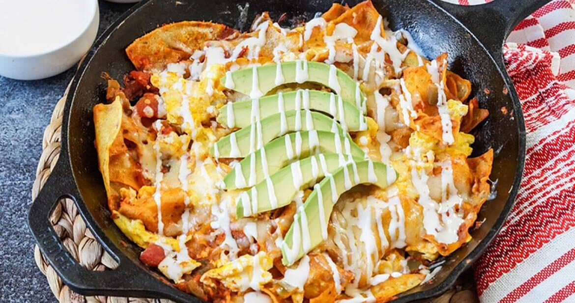 Skillet filled with Chilaquiles Rojos