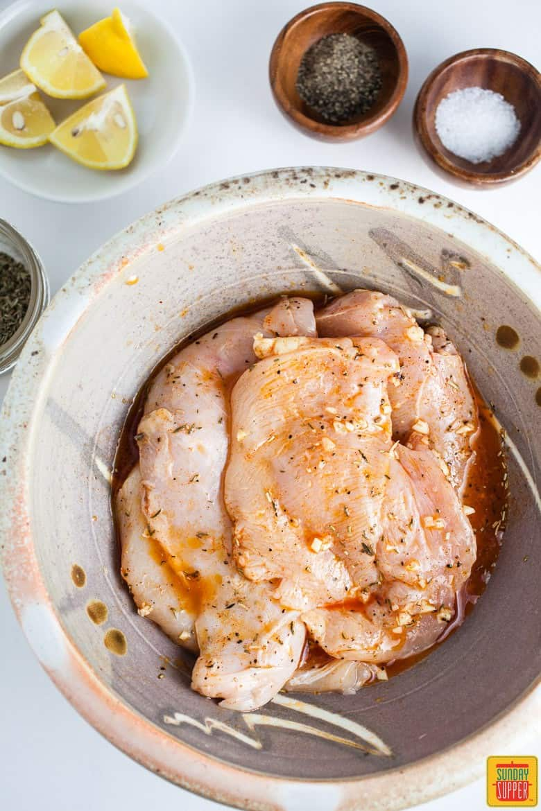 Marinating chicken for Grilled Bruschetta Chicken Breasts