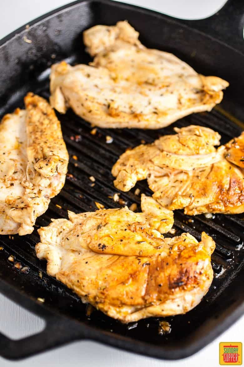 Grilling chicken breasts for grilled bruschetta chicken breasts