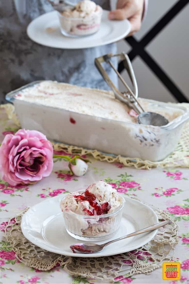 Eating No Churn Banana Raspberry Ice Cream on a table with colorful tablecloth