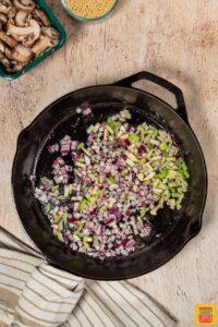 cooking vegetables in a black skillet
