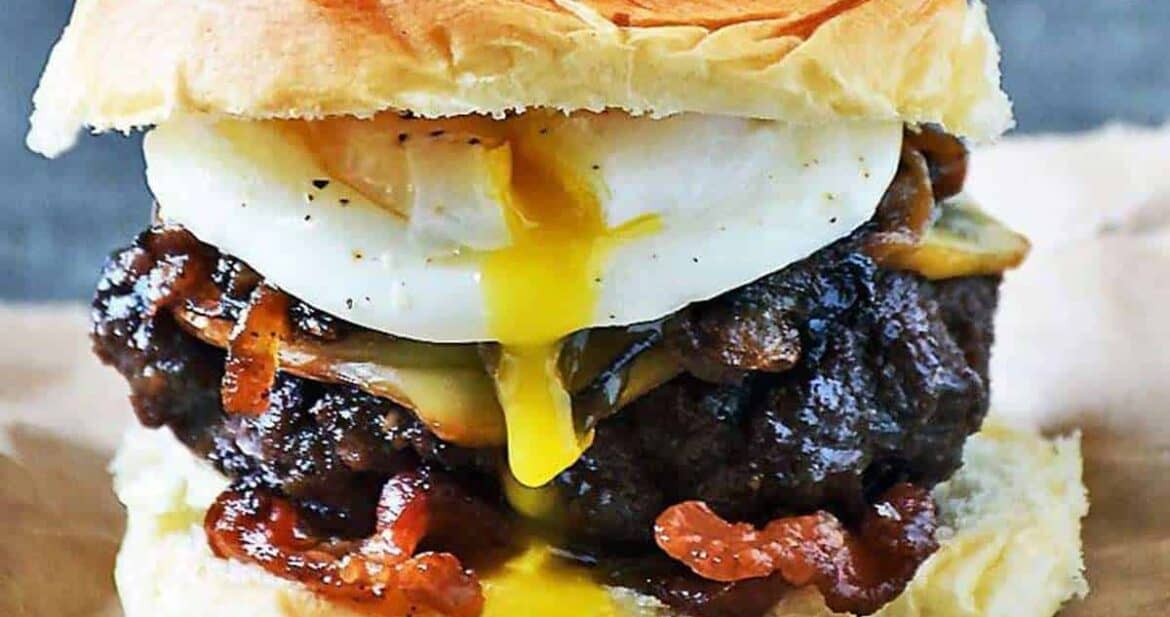 Poached egg burger on a sheet of parchment paper