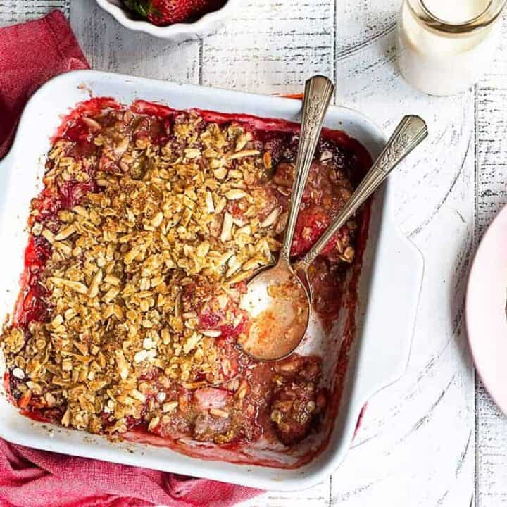 overhead view of strawberry crumble in ceramic baking dish