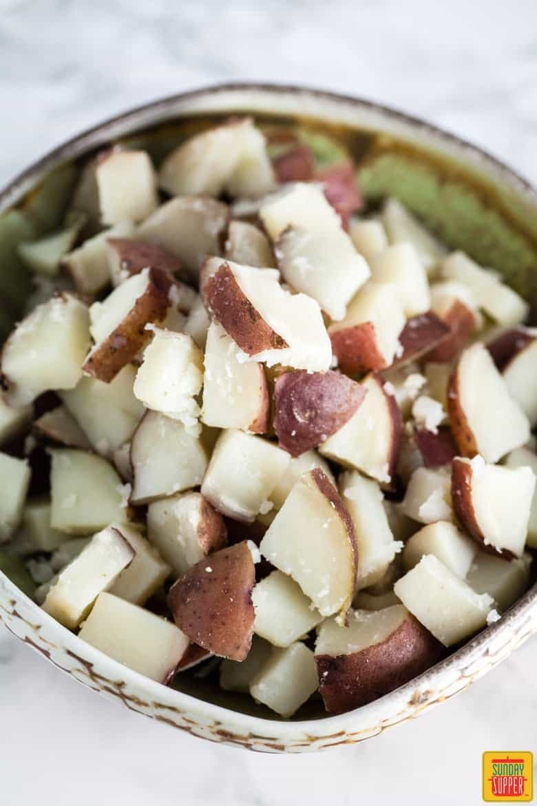 red potatoes in a bowl for spanish potato salad