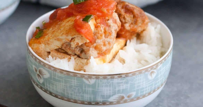 Vietnamese stuffed tofu in tomato sauce over rice