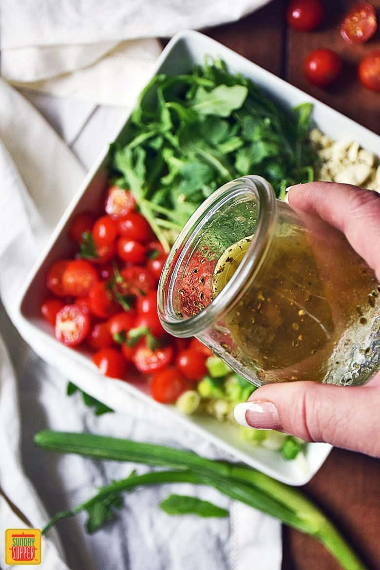Pouring the vinaigrette over the Greek Cauliflower Salad
