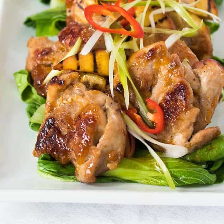 This Asian Peach Glazed Chicken is summer food at it's best. Fresh peaches get transformed into a simple peach preserve, then added with some Asian flavours, become the tastiest peach glazed chicken you've ever had.