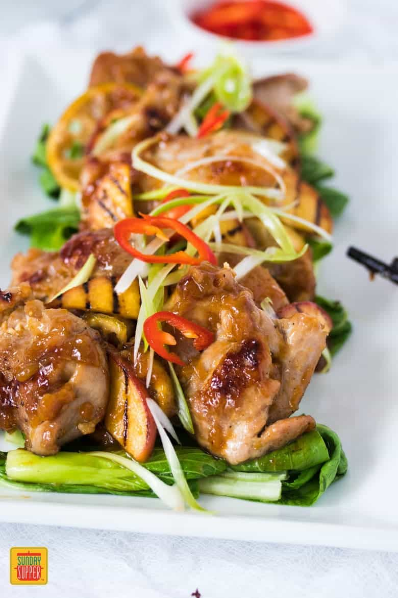 Asian Peach Glazed Chicken served on a white platter