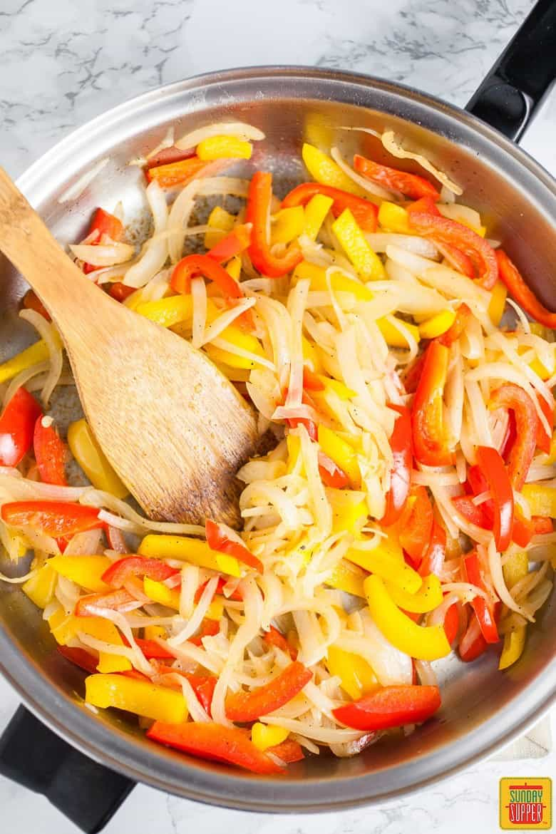 Cooking the peppers for Philly Cheeseteak Sliders in a pan