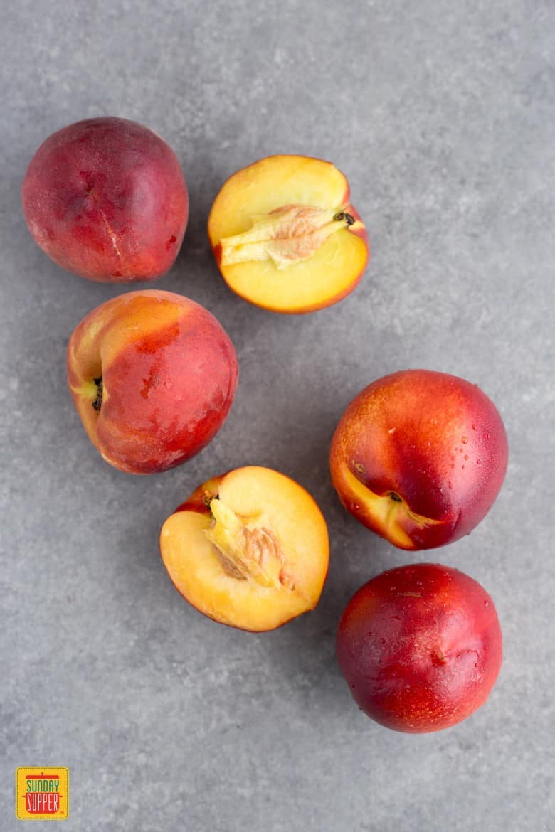 Nectarines and peaches cut in half on the counter