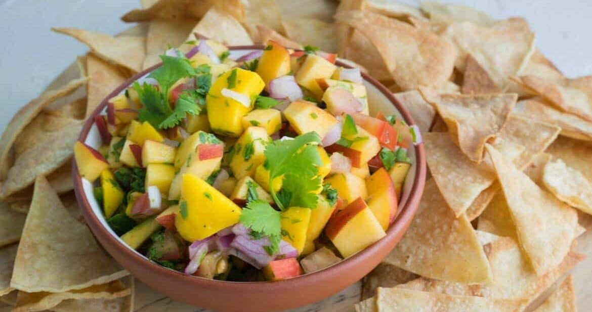 bowl of peach mango salsa with tortilla chips