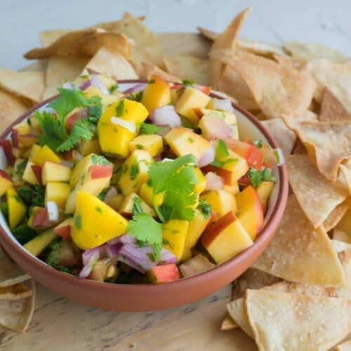 bowl of peach mango salsa with tortilla chips