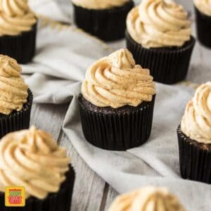 These Chocolate Pumpkin Cupcakes are moist and fluffy marbled cupcakes topped off with a delectable, creamy Spiced Pumpkin Frosting.