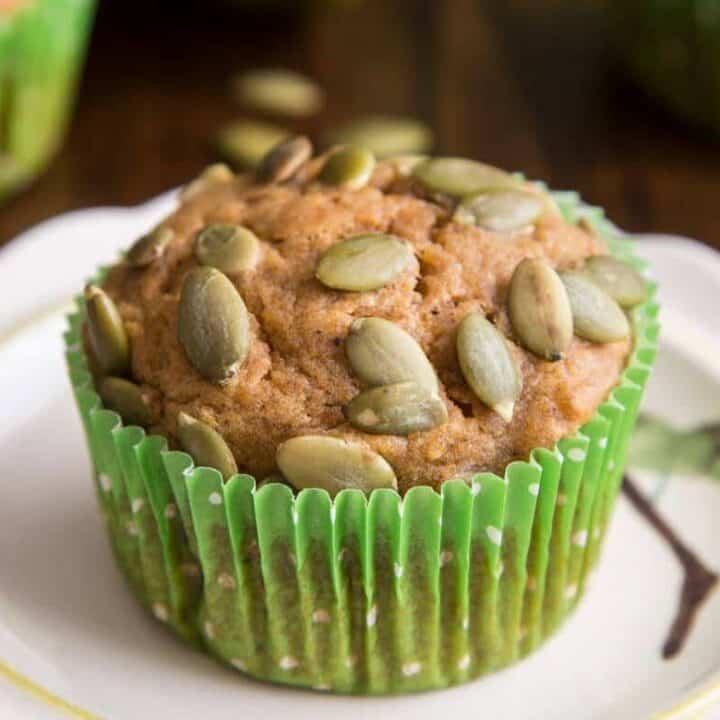 Easy Pumpkin Muffin Recipe muffin on a white serving plate