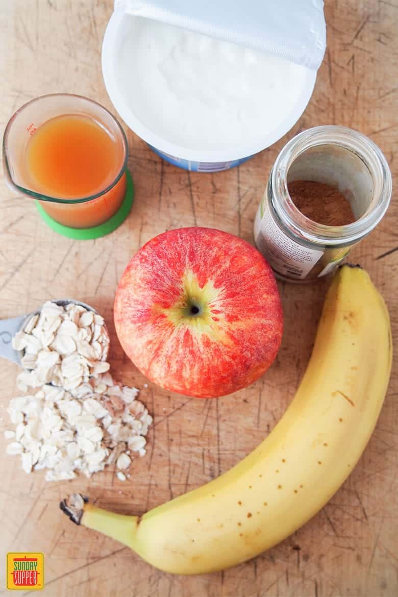 apple banana smoothie ingredients on a cutting board