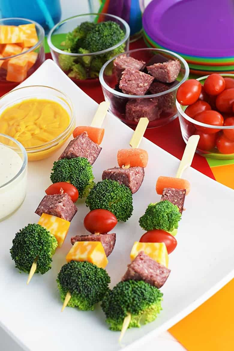 Kid Friendly Lunch Ideas: Salami skewered with cheese and veggies like carrots, broccoli, and tomatoes served with dip