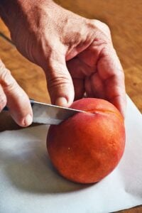 How to cut peaches - cutting around the peach pit