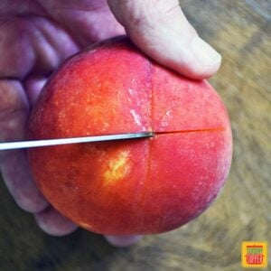 How To Peel Peaches - scoring the end of the peach