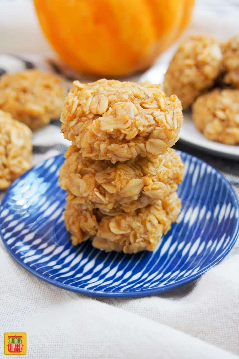 no bake pumpkin cookies on a blue and white plate for Halloween finger foods