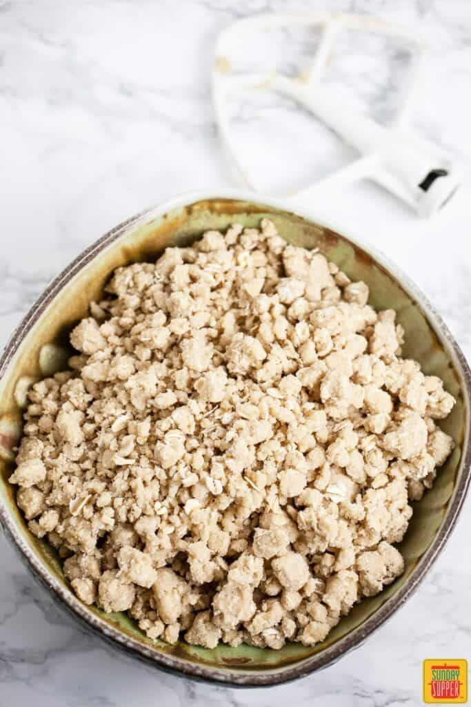 Creating the streusel topping for the apple crisp.