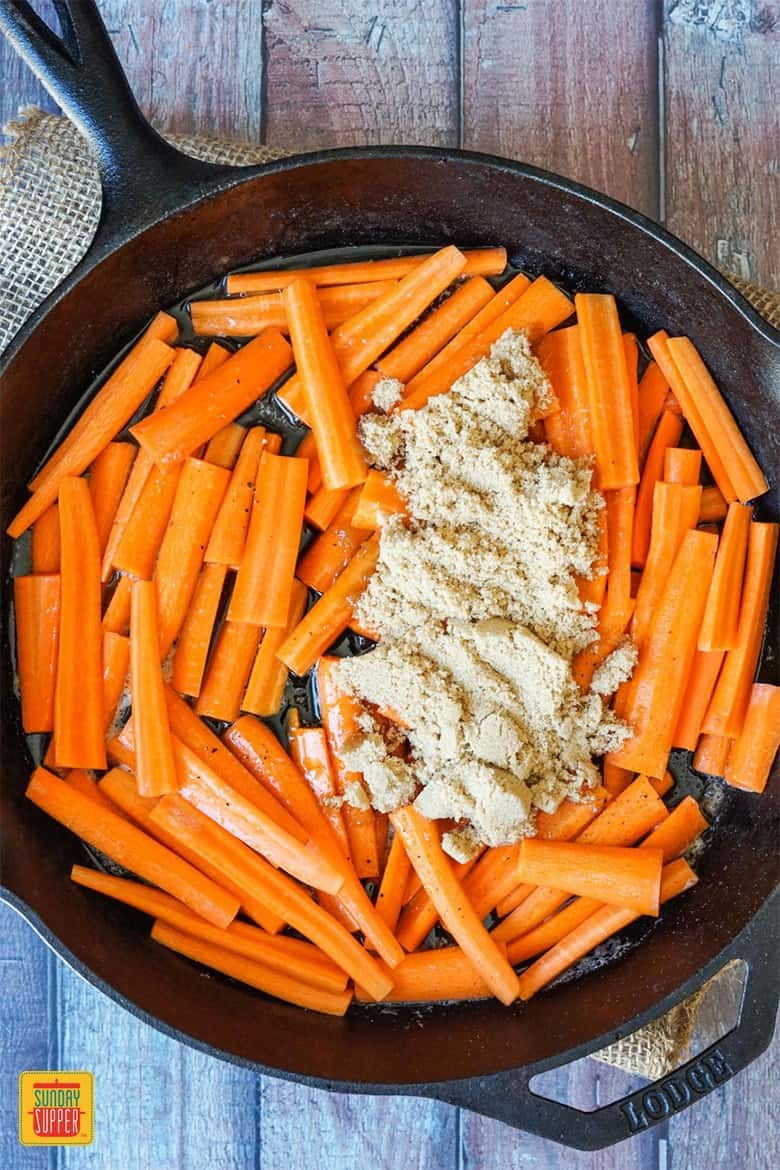 Sliced carrots topped with brown sugar and maple syrup
