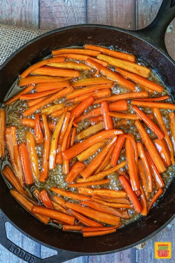 Carrots simmering in a brown sugar maple syrup glaze