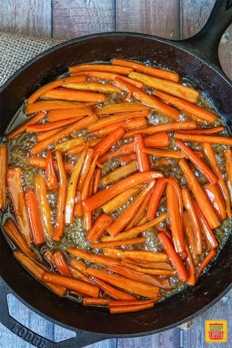 Carrots coated in a bubbling brown sugar maple syrup glaze