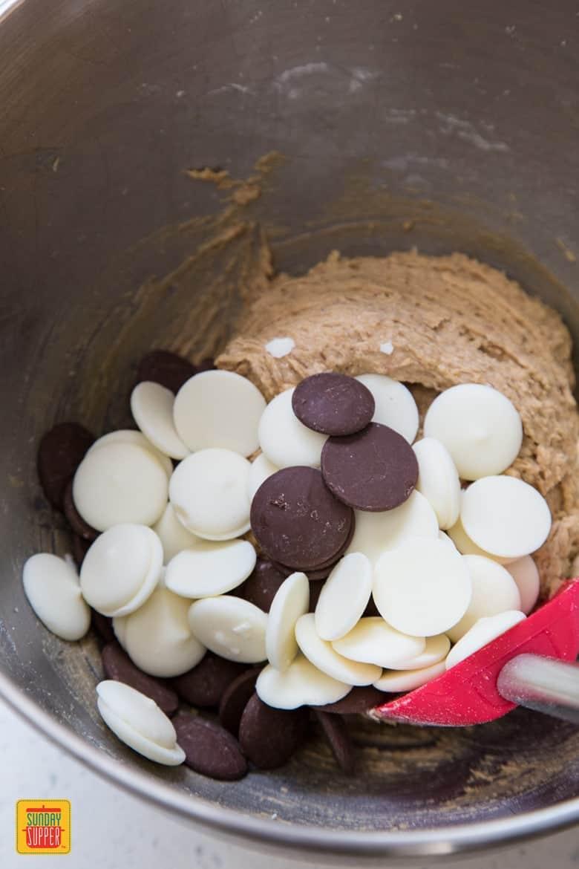 Mixing chocolate into Gluten Free Blondies batter