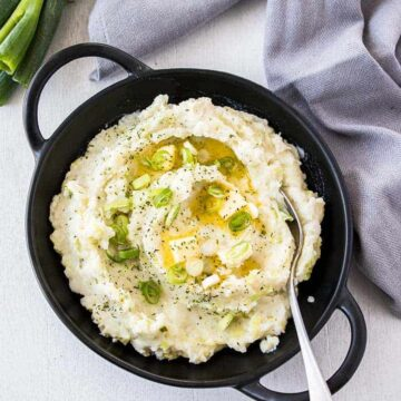 Irish mashed potatoes in a black skillet for Christmas side dishes