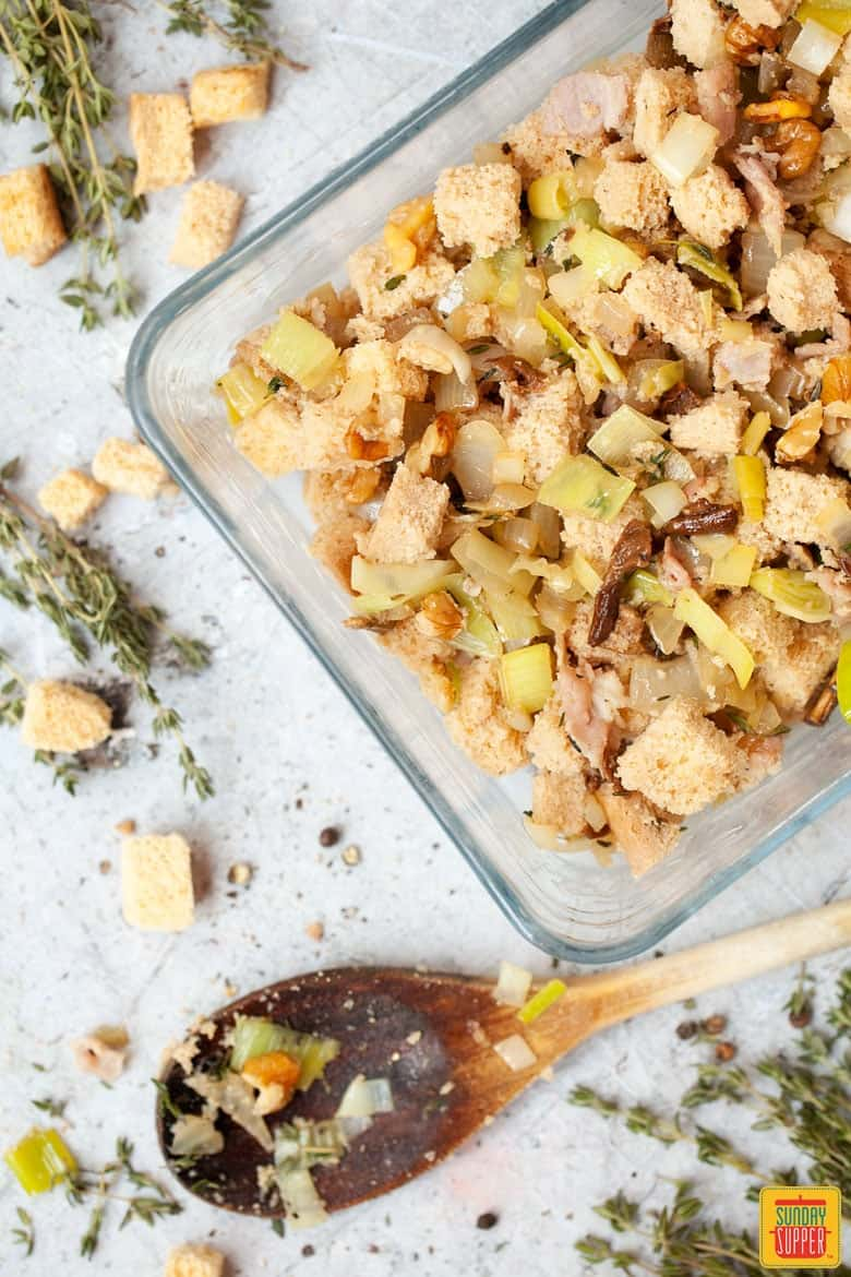 Gluten Free Stuffing ready to bake in oven in a glass dish