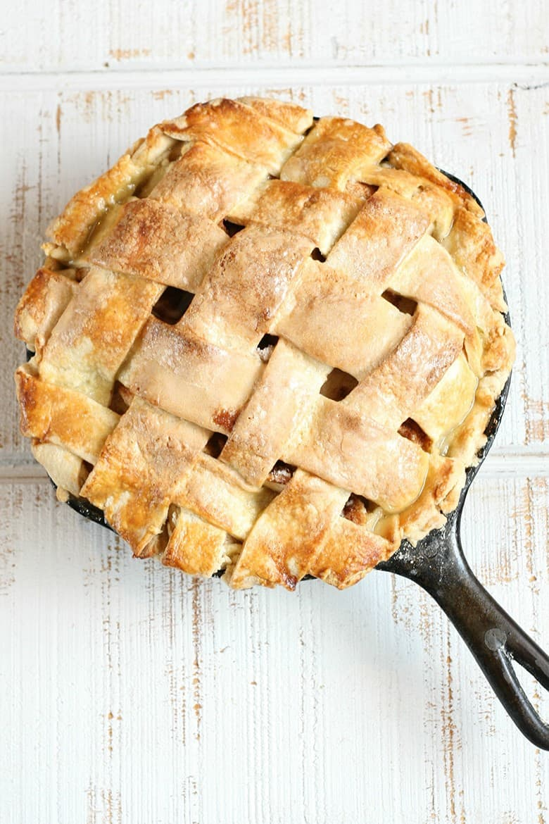 Fresh Apple Recipes: A homemade apple pie with a lattice pie crust served in a skillet