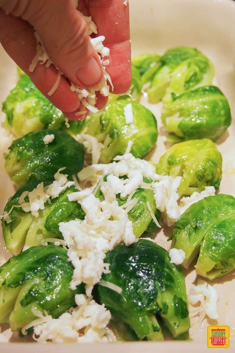 adding cheese to smashed Brussels sprouts