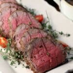 Whole Beef Tenderloin Recipe sliced on white platter