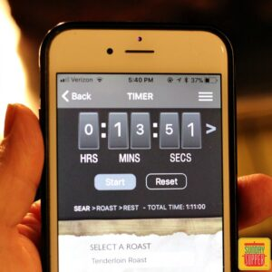 holding phone with timer for roast perfect app