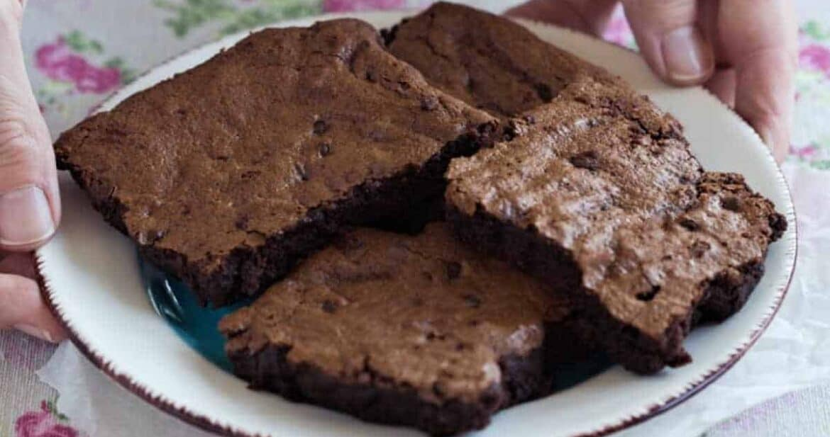 Gluten free fudge brownies on a white plate