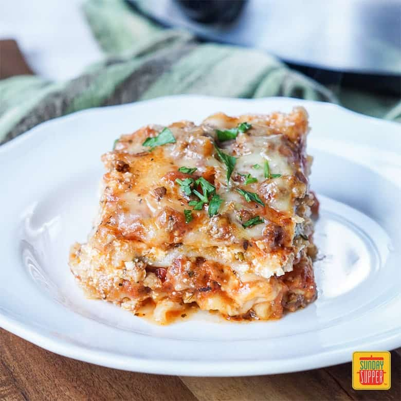 Slice of Slow Cooker Lasagna on a white plate