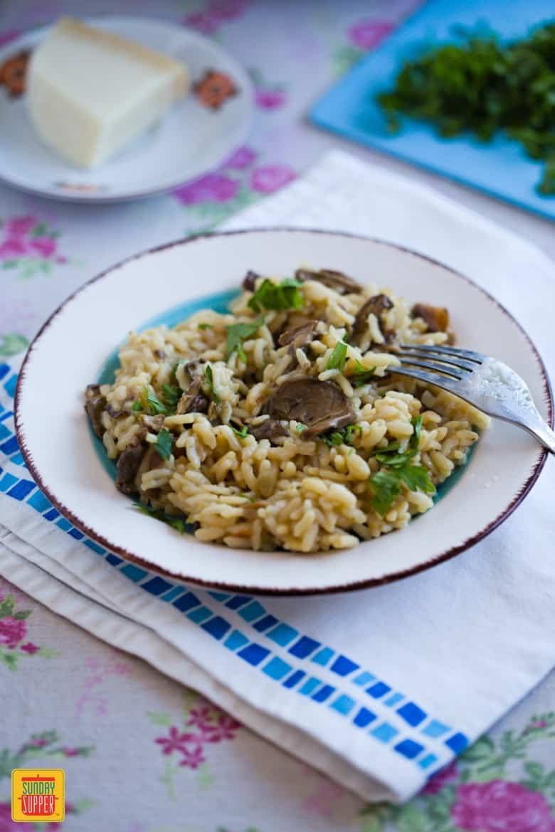 Instant Pot Risotto served on a plate with parmesan cheese and parsley