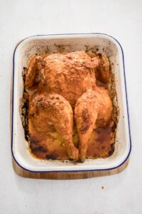 A whole roasted chicken with peri peri sauce