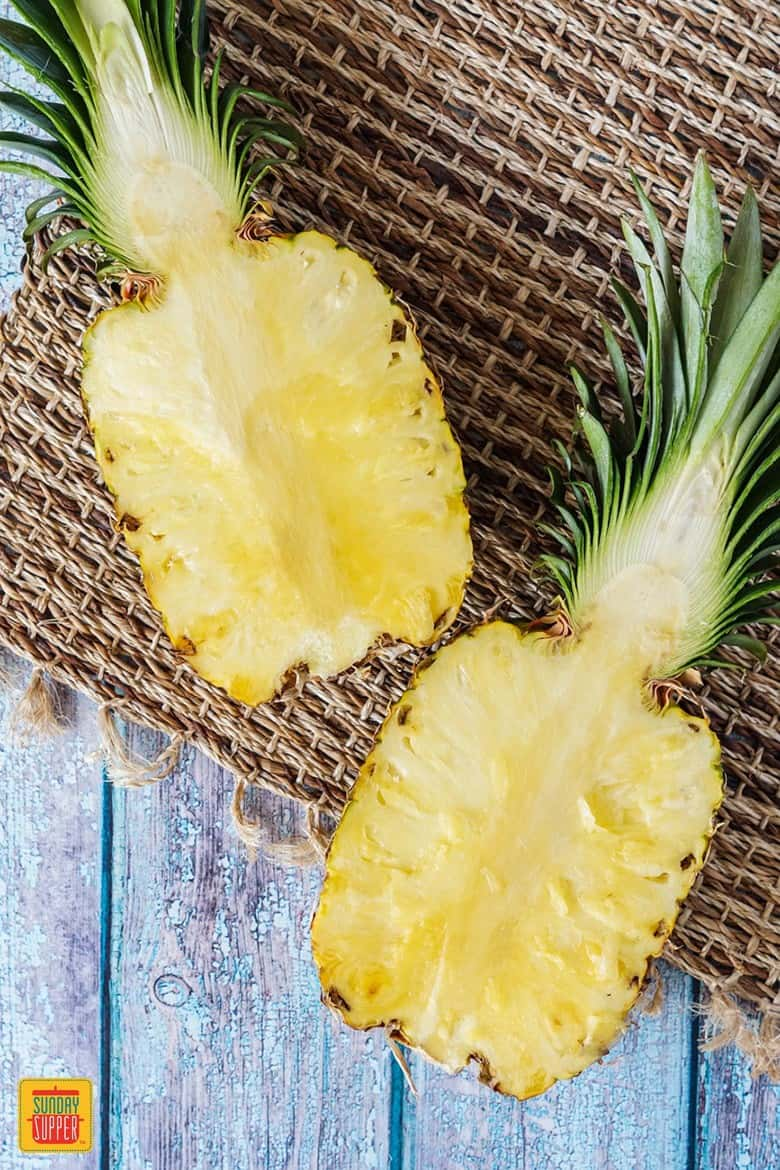 Halved Pineapple to be cut for pineapple teriyaki chicken
