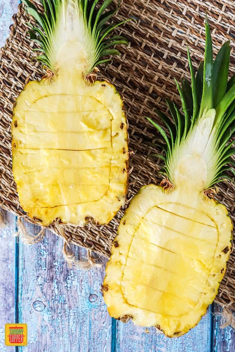 Slicing a pineapple to make a Pineapple Boat for pineapple teriyaki chicken