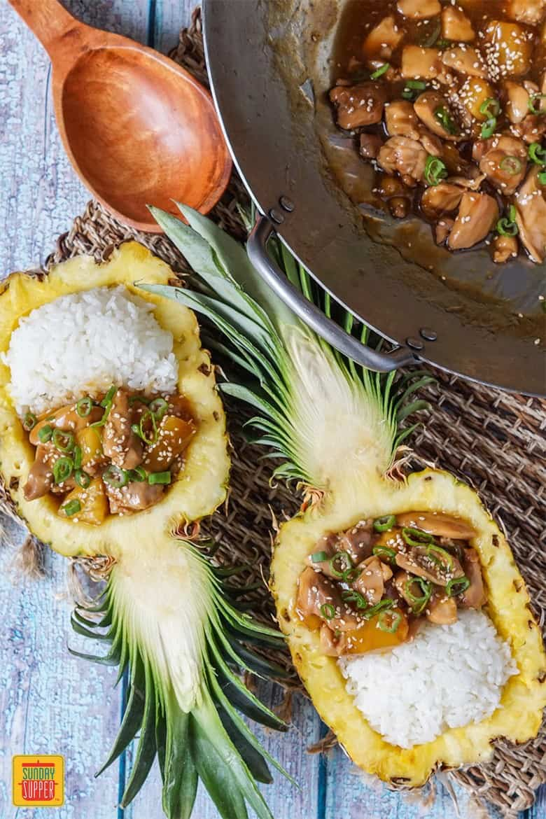 Two servings of Pineapple Teriyaki Chicken in Pineapple Boats