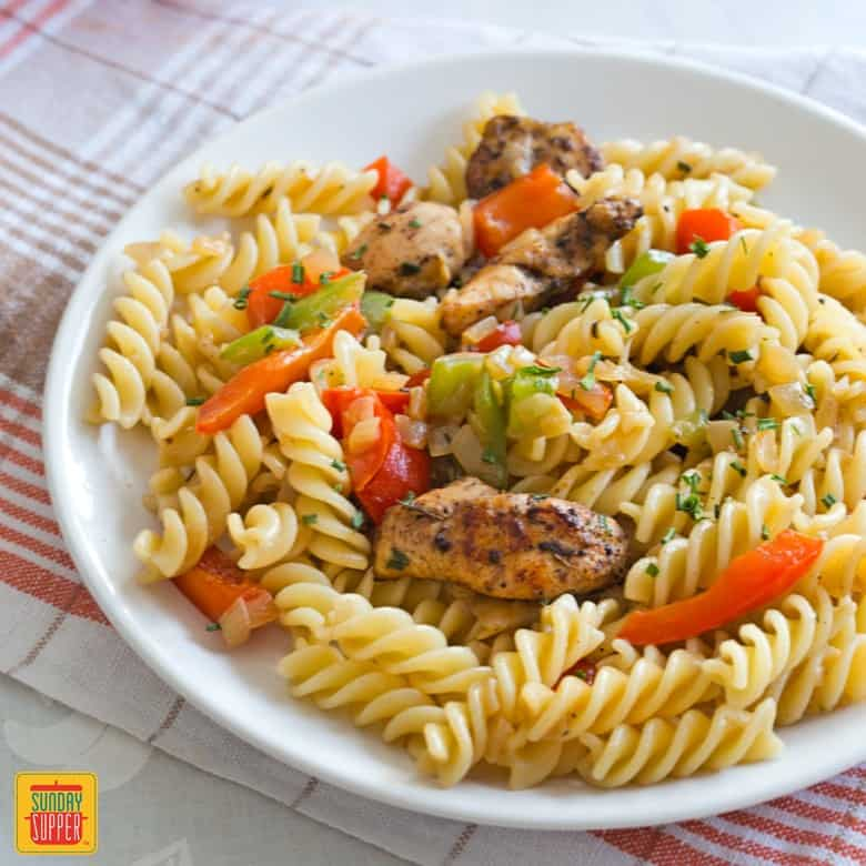 Rasta Pasta Recipe for Two with jerk chicken and bell peppers, served on a plate