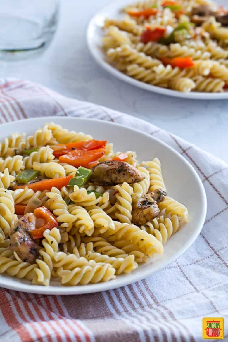 Rasta Pasta recipe for two served on white plates, ready to eat