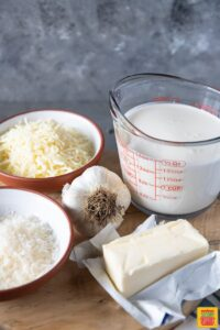 how to make Alfredo Sauce - Alfredo Sauce ingredients on a wooden board