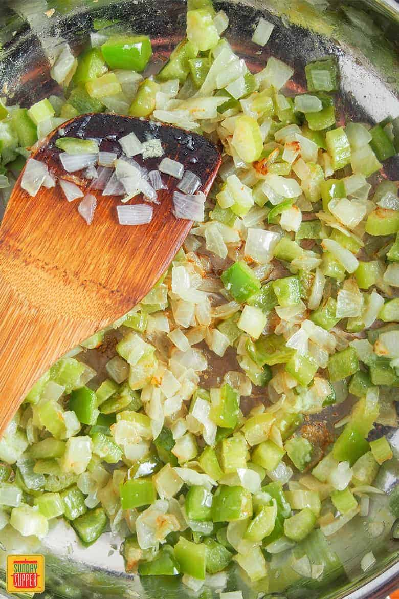 Cooking onion, celery and green pepper for Shrimp Creole Recipe for Two