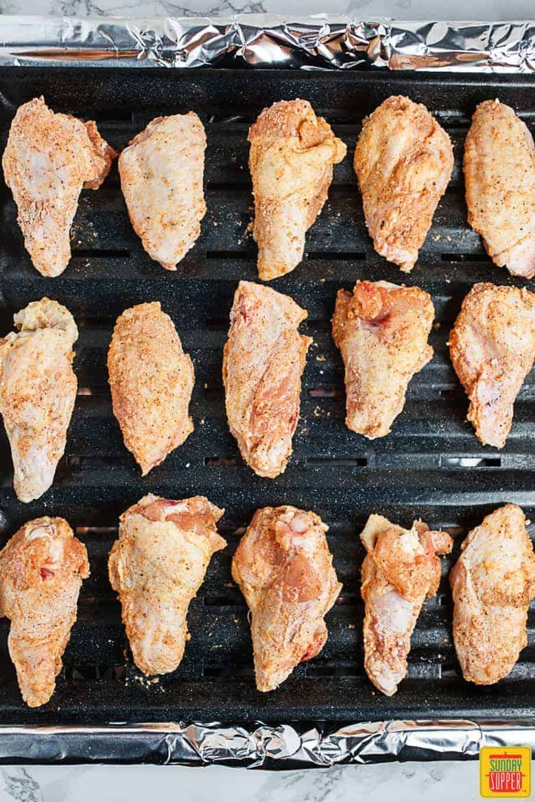 How to Make Buffalo Wings: chicken wings on rack, ready to be baked