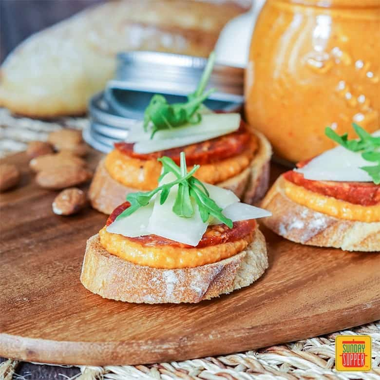 Romesco Sauce recipe with chorizo and manchego on baguette slices