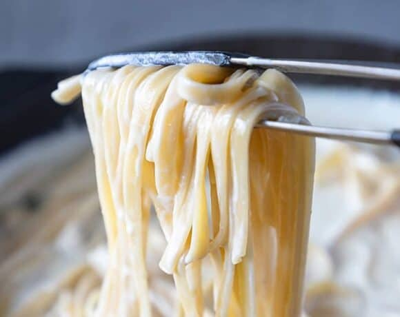 Alfredo sauce in a pot with pasta